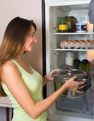 Woman near refrigerator