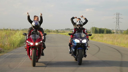 Dancing girls on a motorcycle