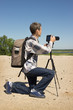 Man makes a video on natural landscape
