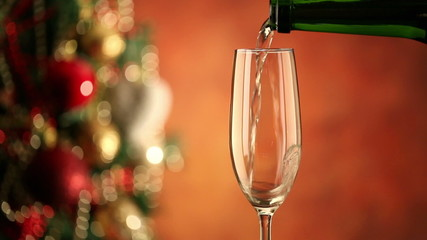 Pouring champagne and christmas tree