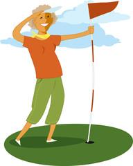 Mature woman holdinf a golf flag