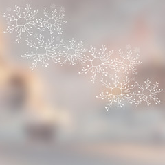 Elegant winter background. Hand drawn snowflakes on a cloudy sky