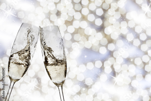 canvas print picture Two glasses with champagne toasting