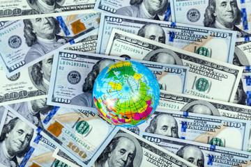 globe on US dollar bill background
