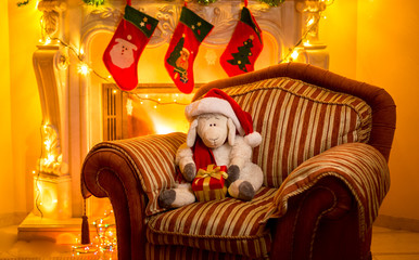 photo of toy lamb sitting on chair at fireplace at Christma