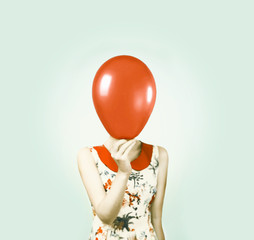 Fashion portrait of a beautiful girl with balloon in hand