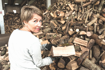 Young woman working in a sawmill