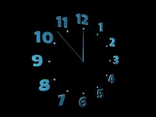 Blue clock isolated on black