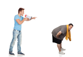 Fat men and his personal trainer with a megaphone
