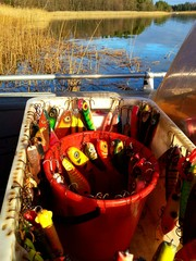 Bucket full of colorful pike fishing lures