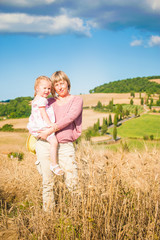Mother and daughter relaxing in Tuscany Landscape, Italy