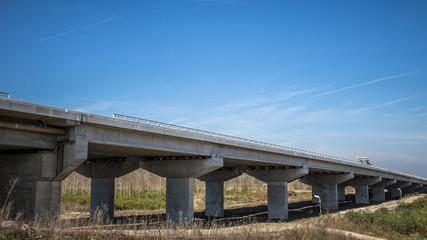 Highway bridge with concrete pylons crossing a river - Belgrade,