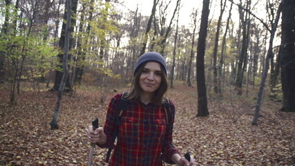 Happy woman trekking in autumn forest, super slow motion, 240fps