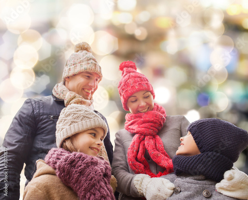 canvas print picture happy family in winter clothes outdoors