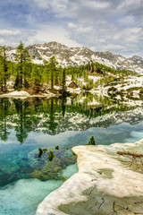 Triglav double lake in spring with mountain reflection