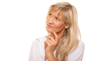 Thinking mature woman looking up isolated