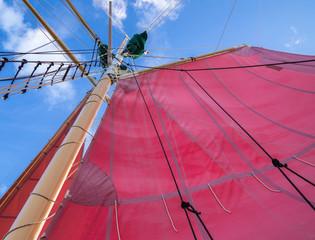 Red Sails and Rigging on Schooner Ship