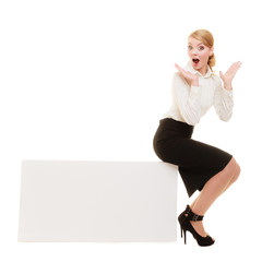 Ad. Businesswoman sitting on blank copy space banner
