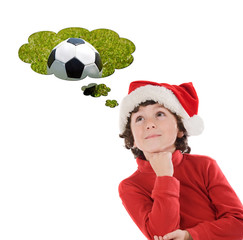 Adorable child with Chistmas hat thinking with a soccer ball