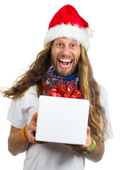 Funny hippie in Santa hat giving a gift on white