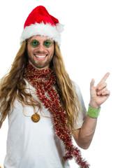 Handsome retro hippie in Santa hat pointing