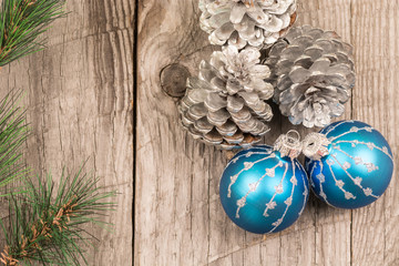 Christmas baubles and pine cones top view
