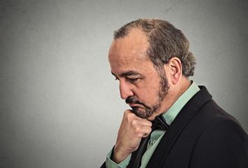Headshot gloomy  sad middle aged business man thinking