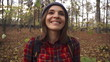 Happy woman enjoying falling leaves in forest, super slow motion