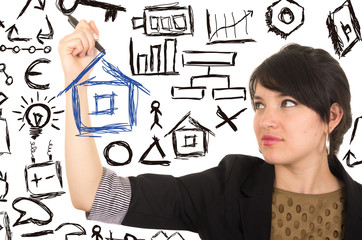 young beautiful woman drawing a house with marker