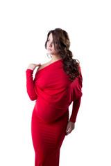 Pensive pregnant woman dressed in elegant dress