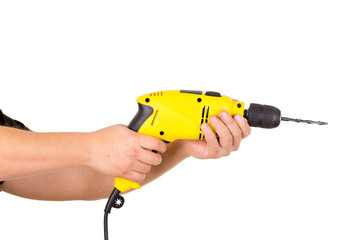 hand holding electric yellow drill tool