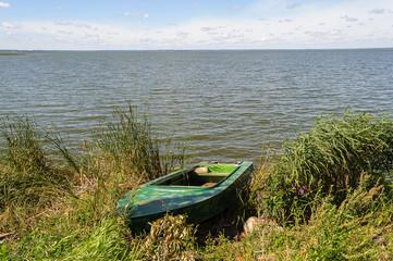 Duralumin fishing boat on the lake
