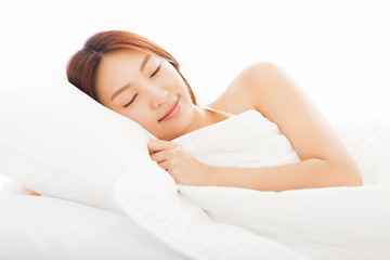 beautiful young  woman sleeping in the bed