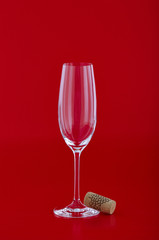 Wine glass with cork over red