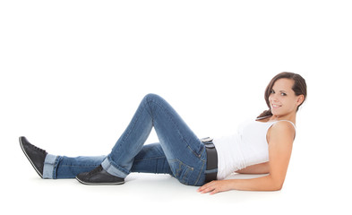 Attractive girl lying on the floor. All on white background.