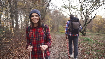 Portrait of smiling, happy woman, man hiking in forest