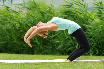 Woman is doing yoga exercise