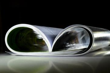 Magazine on reflective surface