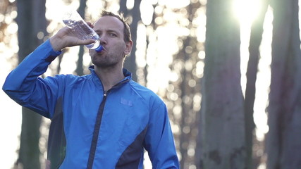 Jogger drinking water in forest, super slow motion, 240fps