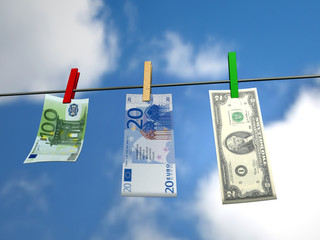 Hanging money on laundry clip and blue sky