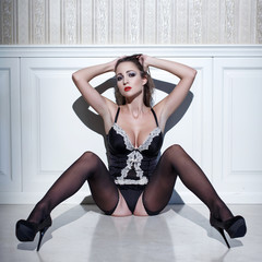 Sexy woman in lingerie sit on floor