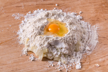 Flour and egg dough preparation on dough board