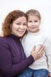 Happy Caucasian mother and preschool daughter portrait