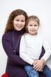 Hugging mother and preschool daughter portrait