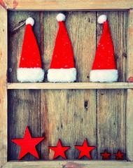 Hintergrund - Weihnachtsfenster mit Nikolausmützen