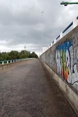 Cycle path on a bridge with graffiti