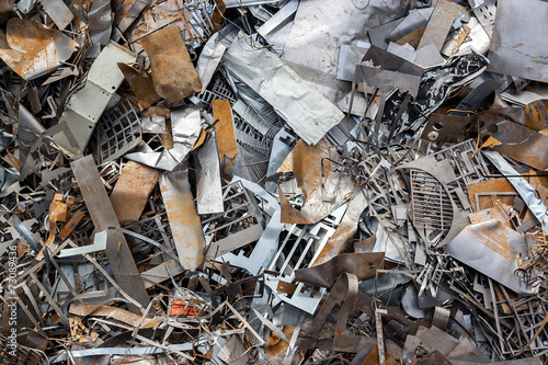 ferrous scrap and mechanisms of various sizes seen from above.