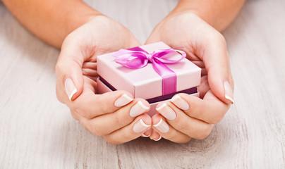 Small gift in women hands