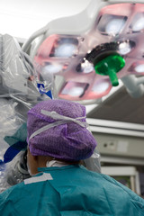 Surgeon operating in hospital
