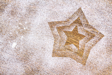 Image of star, made with flour on the table